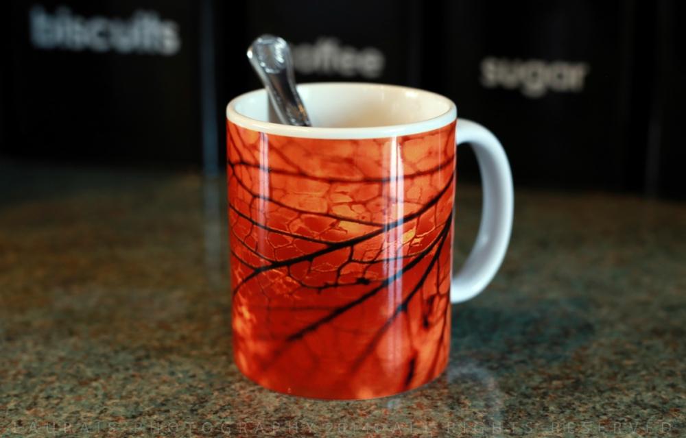 Laurais Arts society6 amber mug